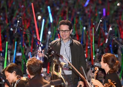 """SAN DIEGO, CA - JULY 10: Director J.J. Abrams and more than 6000 fans enjoyed a surprise """"Star Wars"""" Fan Concert performed by the San Diego Symphony, featuring the classic """"Star Wars"""" music of composer John Williams, at the Embarcadero Marina Park South on July 10, 2015 in San Diego, California. (Photo by Michael Buckner/Getty Images for Disney) *** Local Caption *** J.J. Abrams"""