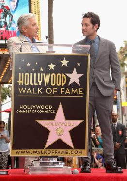 HOLLYWOOD, CA - JULY 01: Actor Michael Douglas (L) honors actor Paul Rudd with a Star on The Hollywood Walk of Fame on July 1, 2015 in Hollywood, California. (Photo by Jesse Grant/Getty Images for Disney) *** Local Caption *** Michael Douglas;Paul Rudd