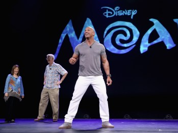 "ANAHEIM, CA - AUGUST 14: (L-R) Producer Osnat Shurer, director John Musker and actor Dwayne Johnson of MOANA took part today in ""Pixar and Walt Disney Animation Studios: The Upcoming Films"" presentation at Disney's D23 EXPO 2015 in Anaheim, Calif. (Photo by Jesse Grant/Getty Images for Disney) *** Local Caption *** Osnat Shurer; Dwayne Johnson; John Musker"