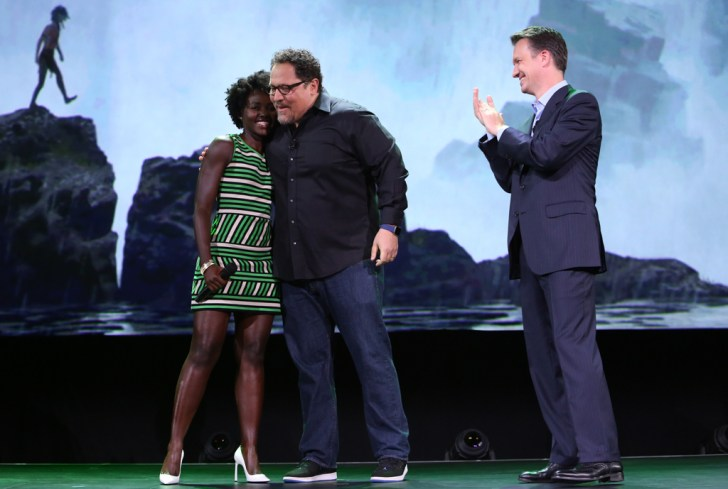 "ANAHEIM, CA - AUGUST 15: (L-R) Actress Lupita Nyong'o and director Jon Favreau of THE JUNGLE BOOK and President of Walt Disney Studios Motion Picture Production Sean Bailey took part today in ""Worlds, Galaxies, and Universes: Live Action at The Walt Disney Studios"" presentation at Disney's D23 EXPO 2015 in Anaheim, Calif. (Photo by Jesse Grant/Getty Images for Disney) *** Local Caption *** Lupita Nyong'o; Jon Favreau; Sean Bailey"