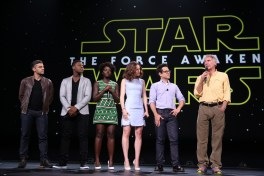 "ANAHEIM, CA - AUGUST 15: (L-R) Actors Oscar Isaac, John Boyega, Lupita Nyong'o, Daisy Ridley, director J.J. Abrams and actor Harrison Ford of STAR WARS: THE FORCE AWAKENS took part today in ""Worlds, Galaxies, and Universes: Live Action at The Walt Disney Studios"" presentation at Disney's D23 EXPO 2015 in Anaheim, Calif. (Photo by Jesse Grant/Getty Images for Disney) *** Local Caption *** Oscar Isaac; John Boyega; Lupita Nyong'o; Daisy Ridley; J.J. Abrams; Harrison Ford"