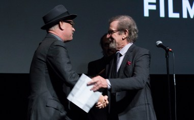 """Tom Hanks joins Steven Spielberg onstage as DreamWorks Pictures and Fox2000 Pictures present the """"Bridge of Spies"""" world premiere at the New York Film Festival at Lincoln Center in New York on October 4, 2015 (Photo: Alex J. Berliner/ABImages)"""