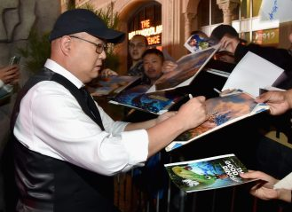 HOLLYWOOD, CA - NOVEMBER 17: Director Peter Sohn signs autographs for fans at the World Premiere Of Disney-Pixar's THE GOOD DINOSAUR at the El Capitan Theatre on November 17, 2015 in Hollywood, California. (Photo by Alberto E. Rodriguez/Getty Images for Disney) *** Local Caption *** Peter Sohn
