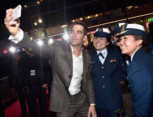 HOLLYWOOD, CA - JANUARY 25: Actor Chris Pine and the cast of Disney?s ?The Finest Hours? were greeted by the U.S. Coast Guard Band, Honor Guard and throngs of fans at the film?s premiere earlier tonight at the TCL Chinese Theater on Hollywood Blvd. The heroic action-thriller opens in U.S. theaters this Friday, January 29. (Photo by Alberto E. Rodriguez/Getty Images for Disney) *** Local Caption *** Chris Pine