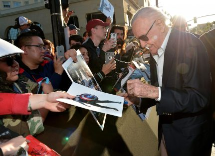 """HOLLYWOOD, CALIFORNIA - APRIL 12: Stan Lee signs autographs during The World Premiere of Marvel's """"Captain America: Civil War"""" at Dolby Theatre on April 12, 2016 in Los Angeles, California. (Photo by Charley Gallay/Getty Images for Disney) *** Local Caption *** Stan Lee"""