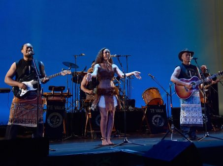 """HOLLYWOOD, CA - NOVEMBER 14: Musicians Olivia Foa'i (C), Opetaia Foa'i (R) and band Te Vaka perform onstage at The World Premiere of Disney's """"MOANA"""" at the El Capitan Theatre on Monday, November 14, 2016 in Hollywood, CA. (Photo by Alberto E. Rodriguez/Getty Images for Disney) *** Local Caption *** Olivia Foa'i; Opetaia Foa'i"""