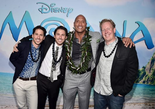 """HOLLYWOOD, CA - NOVEMBER 14: (L-R) Writers Aaron Kandell and Jordan Kandell, actor Dwayne Johnson, and screenwriter Jared Bush attend The World Premiere of Disney's """"MOANA"""" at the El Capitan Theatre on Monday, November 14, 2016 in Hollywood, CA. (Photo by Alberto E. Rodriguez/Getty Images for Disney) *** Local Caption *** Dwayne Johnson; Jared Bush; Aaron Kandell; Jordan Kandell"""