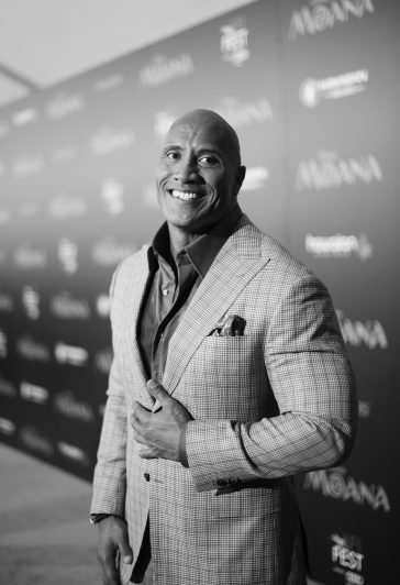 "HOLLYWOOD, CA - NOVEMBER 14: (EDITORS NOTE: Image has been shot in black and white. Color version not available.) Actor Dwayne Johnson attends The World Premiere of Disney's ""MOANA"" at the El Capitan Theatre on Monday, November 14, 2016 in Hollywood, CA. (Photo by Charley Gallay/Getty Images for Disney) *** Local Caption *** Dwayne Johnson"