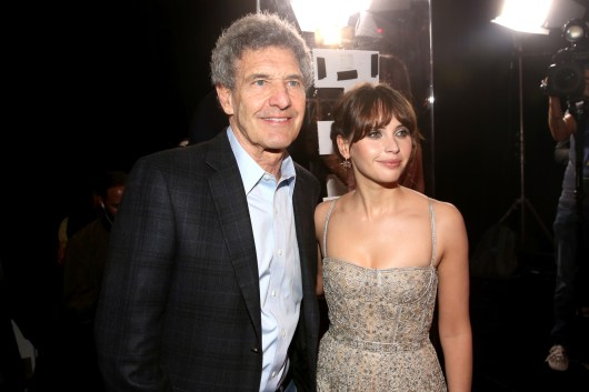 """HOLLYWOOD, CA - DECEMBER 10: Chairman, The Walt Disney Studios, Alan Horn (L) and actress Felicity Jones attend The World Premiere of Lucasfilm's highly anticipated, first-ever, standalone Star Wars adventure, """"Rogue One: A Star Wars Story"""" at the Pantages Theatre on December 10, 2016 in Hollywood, California. (Photo by Jesse Grant/Getty Images for Disney) *** Local Caption *** Alan Horn; Felicity Jones"""