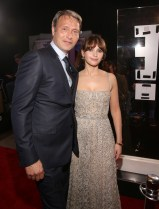 """HOLLYWOOD, CA - DECEMBER 10: Actor Mads Mikkelsen (L) and actress Felicity Jones attend The World Premiere of Lucasfilm's highly anticipated, first-ever, standalone Star Wars adventure, """"Rogue One: A Star Wars Story"""" at the Pantages Theatre on December 10, 2016 in Hollywood, California. (Photo by Jesse Grant/Getty Images for Disney) *** Local Caption *** Felicity Jones; Mads Mikkelsen"""