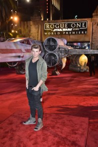 """HOLLYWOOD, CA - DECEMBER 10: Actor Garrett Clayton attends The World Premiere of Lucasfilm's highly anticipated, first-ever, standalone Star Wars adventure, """"Rogue One: A Star Wars Story"""" at the Pantages Theatre on December 10, 2016 in Hollywood, California. (Photo by Marc Flores/Getty Images for Disney) *** Local Caption *** Garrett Clayton"""