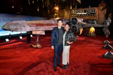 "HOLLYWOOD, CA - DECEMBER 10: Actors Harry Shum Jr. (L) and Shelby Rabara attends The World Premiere of Lucasfilm's highly anticipated, first-ever, standalone Star Wars adventure, ""Rogue One: A Star Wars Story"" at the Pantages Theatre on December 10, 2016 in Hollywood, California. (Photo by Marc Flores/Getty Images for Disney) *** Local Caption *** Harry Shum Jr; Shelby Rabara"