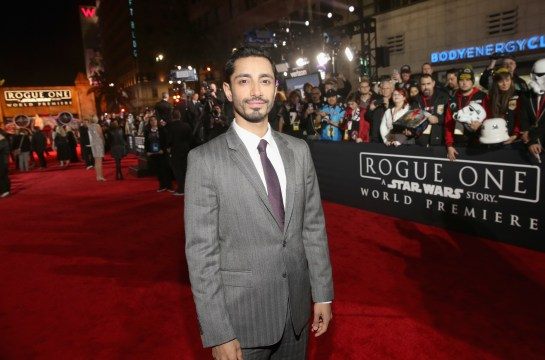 """HOLLYWOOD, CA - DECEMBER 10: Actor Riz Ahmed attends The World Premiere of Lucasfilm's highly anticipated, first-ever, standalone Star Wars adventure, """"Rogue One: A Star Wars Story"""" at the Pantages Theatre on December 10, 2016 in Hollywood, California. (Photo by Jesse Grant/Getty Images for Disney) *** Local Caption *** Riz Ahmed"""