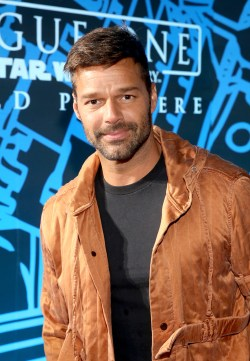 "HOLLYWOOD, CA - DECEMBER 10: Singer Ricky Martin attends The World Premiere of Lucasfilm's highly anticipated, first-ever, standalone Star Wars adventure, ""Rogue One: A Star Wars Story"" at the Pantages Theatre on December 10, 2016 in Hollywood, California. (Photo by Jesse Grant/Getty Images for Disney) *** Local Caption *** Ricky Martin"
