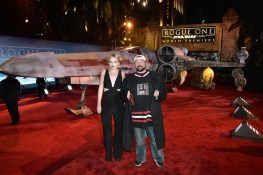 """HOLLYWOOD, CA - DECEMBER 10: Actress Harley Quinn Smith (L) and director Kevin Smith attend The World Premiere of Lucasfilm's highly anticipated, first-ever, standalone Star Wars adventure, """"Rogue One: A Star Wars Story"""" at the Pantages Theatre on December 10, 2016 in Hollywood, California. (Photo by Marc Flores/Getty Images for Disney) *** Local Caption *** Harley Quinn Smith; Kevin Smith"""