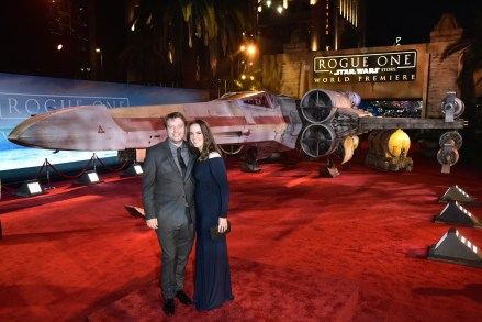 "HOLLYWOOD, CA - DECEMBER 10: Director Gareth Edwards (L) and guest attend The World Premiere of Lucasfilm's highly anticipated, first-ever, standalone Star Wars adventure, ""Rogue One: A Star Wars Story"" at the Pantages Theatre on December 10, 2016 in Hollywood, California. (Photo by Marc Flores/Getty Images for Disney) *** Local Caption *** Gareth Edwards"