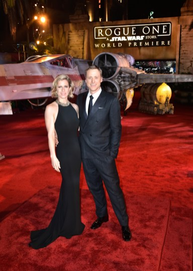 """HOLLYWOOD, CA - DECEMBER 10: Actor Alan Tudyk (R) and Charissa Barton attend The World Premiere of Lucasfilm's highly anticipated, first-ever, standalone Star Wars adventure, """"Rogue One: A Star Wars Story"""" at the Pantages Theatre on December 10, 2016 in Hollywood, California. (Photo by Marc Flores/Getty Images for Disney) *** Local Caption *** Alan Tudyk; Charissa Barton"""