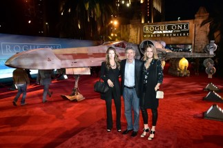 """.HOLLYWOOD, CA - DECEMBER 10: (L-R) Cassidy Horn, Chairman, The Walt Disney Studios, Alan Horn and actress Cody Horn attend The World Premiere of Lucasfilm's highly anticipated, first-ever, standalone Star Wars adventure, """"Rogue One: A Star Wars Story"""" at the Pantages Theatre on December 10, 2016 in Hollywood, California. (Photo by Marc Flores/Getty Images for Disney) *** Local Caption *** Alan Horn; Cody Horn; Cassidy Horn"""
