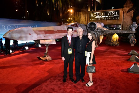 """HOLLYWOOD, CA - DECEMBER 10: (L-R) Dylan Michael Douglas, actor Michael Douglas and Carys Zeta-Douglas attend The World Premiere of Lucasfilm's highly anticipated, first-ever, standalone Star Wars adventure, """"Rogue One: A Star Wars Story"""" at the Pantages Theatre on December 10, 2016 in Hollywood, California. (Photo by Marc Flores/Getty Images for Disney) *** Local Caption *** Dylan Michael Douglas; Michael Douglas; Carys Zeta-Douglas"""