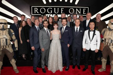 "HOLLYWOOD, CA - DECEMBER 10: (L-R front row) Actors Mads Mikkelsen, Riz Ahmed, Felicity Jones, Diego Luna, Alan Tudyk and Donnie Yen (back row) Producer Allison Shearmur, Screenwriter Chris Weitz, Walt Disney Studios President Alan Bergman, Executive producer John Knoll, Director Gareth Edwards, Chairman, The Walt Disney Studios, Alan Horn, Producer Kathleen Kennedy, actor Ben Mendelsohn, Composer Michael Giacchino, Producer Simon Emanuel and The Walt Disney Company Chairman and CEO Bob Iger attend The World Premiere of Lucasfilm's highly anticipated, first-ever, standalone Star Wars adventure, ""Rogue One: A Star Wars Story"" at the Pantages Theatre on December 10, 2016 in Hollywood, California. (Photo by Rich Polk/Getty Images for Disney) *** Local Caption *** Mads Mikkelsen; Riz Ahmed; Felicity Jones; Diego Luna; Donnie Yen; Allison Shearmur; Chris Weitz; Alan Bergman; John Knoll; Gareth Edwards; Alan Horn; Kathleen Kennedy; Ben Mendelsohn; Michael Giacchino; Simon Emanuel; Bob Iger"