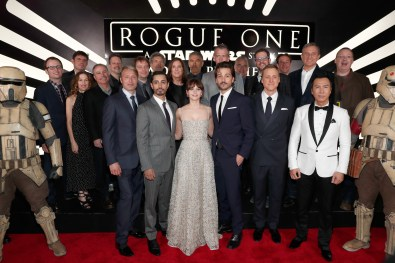 """HOLLYWOOD, CA - DECEMBER 10: (L-R front row) Actors Mads Mikkelsen, Riz Ahmed, Felicity Jones, Diego Luna, Alan Tudyk and Donnie Yen (back row) Producer Allison Shearmur, Screenwriter Chris Weitz, Walt Disney Studios President Alan Bergman, Executive producer John Knoll, Director Gareth Edwards, Chairman, The Walt Disney Studios, Alan Horn, Producer Kathleen Kennedy, actor Ben Mendelsohn, Composer Michael Giacchino, Producer Simon Emanuel and The Walt Disney Company Chairman and CEO Bob Iger attend The World Premiere of Lucasfilm's highly anticipated, first-ever, standalone Star Wars adventure, """"Rogue One: A Star Wars Story"""" at the Pantages Theatre on December 10, 2016 in Hollywood, California. (Photo by Rich Polk/Getty Images for Disney) *** Local Caption *** Mads Mikkelsen; Riz Ahmed; Felicity Jones; Diego Luna; Donnie Yen; Allison Shearmur; Chris Weitz; Alan Bergman; John Knoll; Gareth Edwards; Alan Horn; Kathleen Kennedy; Ben Mendelsohn; Michael Giacchino; Simon Emanuel; Bob Iger"""