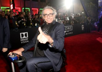 """HOLLYWOOD, CA - DECEMBER 10: Actor Peter Mayhew attends The World Premiere of Lucasfilm's highly anticipated, first-ever, standalone Star Wars adventure, """"Rogue One: A Star Wars Story"""" at the Pantages Theatre on December 10, 2016 in Hollywood, California. (Photo by Jesse Grant/Getty Images for Disney) *** Local Caption *** Peter Mayhew"""