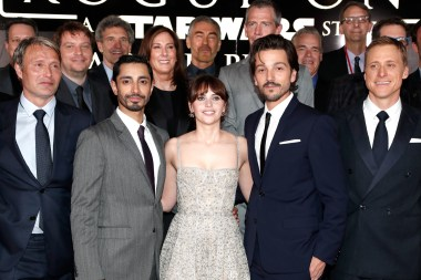 "HOLLYWOOD, CA - DECEMBER 10: (L-R front row) Actors Mads Mikkelsen, Riz Ahmed, Felicity Jones, Diego Luna and Alan Tudyk (back row) Director Gareth Edwards, Chairman, The Walt Disney Studios, Alan Horn, Producer Kathleen Kennedy, Actor Ben Mendelsohn and Executive producer Jason McGatlin attend The World Premiere of Lucasfilm's highly anticipated, first-ever, standalone Star Wars adventure, ""Rogue One: A Star Wars Story"" at the Pantages Theatre on De"