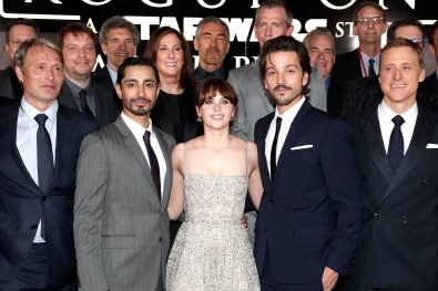 """HOLLYWOOD, CA - DECEMBER 10: (L-R front row) Actors Mads Mikkelsen, Riz Ahmed, Felicity Jones, Diego Luna and Alan Tudyk (back row) Director Gareth Edwards, Chairman, The Walt Disney Studios, Alan Horn, Producer Kathleen Kennedy, Actor Ben Mendelsohn and Executive producer Jason McGatlin attend The World Premiere of Lucasfilm's highly anticipated, first-ever, standalone Star Wars adventure, """"Rogue One: A Star Wars Story"""" at the Pantages Theatre on December 10, 2016 in Hollywood, California. (Photo by Rich Polk/Getty Images for Disney) *** Local Caption *** Mads Mikkelsen; Riz Ahmed; Felicity Jones; Diego Luna; Alan Tudyk; Gareth Edwards; Alan Horn; Kathleen Kennedy; Ben mendelsohn; Jason McGatlin"""
