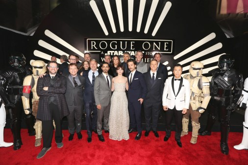 """HOLLYWOOD, CA - DECEMBER 10: (L-R front row) Composer Michael Giacchino, director Gareth Edwards, actors Mads Mikkelsen, Riz Ahmed, Felicity Jones, Diego Luna, Alan Tudyk and Donnie Yen (back row) Executive producer John Knoll, Producer Allison Shearmurs, Kathleen Kennedy, actor Ben Mendelsohn and producer Simon Emanuel attend The World Premiere of Lucasfilm's highly anticipated, first-ever, standalone Star Wars adventure, """"Rogue One: A Star Wars Story"""" at the Pantages Theatre on December 10, 2016 in Hollywood, California. (Photo by Jesse Grant/Getty Images for Disney) *** Local Caption *** Michael Giacchino; Gareth Edwards; Mads Mikkelsen; Riz Ahmed; Felicity Jones; Diego Luna; Alan Tudyk; Donnie Yen; John Knoll; Allison Shearmur; Kathleen Kennedy; Ben Mendelsohn"""