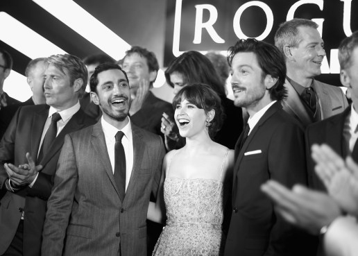 """HOLLYWOOD, CA - DECEMBER 10: (EDITORS NOTE: Image has been shot in black and white. Color version not available.) (L-R) Actors Mads Mikkelsen, Riz Ahmed, Felicity Jones, Diego Luna, and Ben Mendelsohn attend The World Premiere of Lucasfilm's highly anticipated, first-ever, standalone Star Wars adventure, """"Rogue One: A Star Wars Story"""" at the Pantages Theatre on December 10, 2016 in Hollywood, California. (Photo by Charley Gallay/Getty Images for Disney) *** Local Caption *** Mads Mikkelsen; Riz Ahmed; Felicity Jones; Diego Luna; Ben Mendelsohn"""