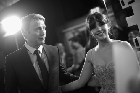 """HOLLYWOOD, CA - DECEMBER 10: (EDITORS NOTE: Image has been shot in black and white. Color version not available.) Actors Mads Mikkelsen (L) and Felicity Jones attend The World Premiere of Lucasfilm's highly anticipated, first-ever, standalone Star Wars adventure, """"Rogue One: A Star Wars Story"""" at the Pantages Theatre on December 10, 2016 in Hollywood, California. (Photo by Charley Gallay/Getty Images for Disney) *** Local Caption *** Felicity Jones; Mads Mikkelsen"""