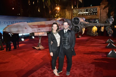 "HOLLYWOOD, CA - DECEMBER 10: Andrea Datzman (L) and composer Michael Giacchino attend The World Premiere of Lucasfilm's highly anticipated, first-ever, standalone Star Wars adventure, ""Rogue One: A Star Wars Story"" at the Pantages Theatre on December 10, 2016 in Hollywood, California. (Photo by Marc Flores/Getty Images for Disney) *** Local Caption *** Andrea Datzman; Michael Giacchino"