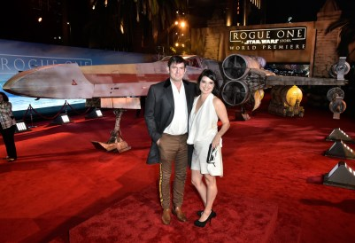 "HOLLYWOOD, CA - DECEMBER 10: Screenwriter Chris Weitz (L) and Mercedes Weitz attend The World Premiere of Lucasfilm's highly anticipated, first-ever, standalone Star Wars adventure, ""Rogue One: A Star Wars Story"" at the Pantages Theatre on December 10, 2016 in Hollywood, California. (Photo by Marc Flores/Getty Images for Disney) *** Local Caption *** Chris Weitz; Mercedes Weitz"