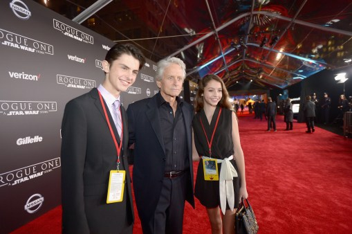 """HOLLYWOOD, CA - DECEMBER 10: (L-R) Dylan Michael Douglas, Michael Douglas and Carys Zeta-Douglas attend The World Premiere of Lucasfilm's highly anticipated, first-ever, standalone Star Wars adventure, """"Rogue One: A Star Wars Story"""" at the Pantages Theatre on December 10, 2016 in Hollywood, California. (Photo by Charley Gallay/Getty Images for Disney) *** Local Caption *** Michael Douglas; Dylan Michael Douglas; Carys Zeta-Douglas"""