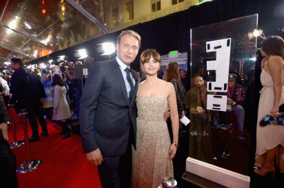 """HOLLYWOOD, CA - DECEMBER 10: Actors Mads Mikkelsen (L) and Felicity Jones attend The World Premiere of Lucasfilm's highly anticipated, first-ever, standalone Star Wars adventure, """"Rogue One: A Star Wars Story"""" at the Pantages Theatre on December 10, 2016 in Hollywood, California. (Photo by Charley Gallay/Getty Images for Disney) *** Local Caption *** Mads Mikkelsen; Felicity Jones"""