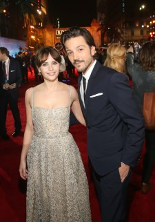 """HOLLYWOOD, CA - DECEMBER 10: Actors Felicity Jones and Diego Luna attend The World Premiere of Lucasfilm's highly anticipated, first-ever, standalone Star Wars adventure, """"Rogue One: A Star Wars Story"""" at the Pantages Theatre on December 10, 2016 in Hollywood, California. (Photo by Jesse Grant/Getty Images for Disney) *** Local Caption *** Diego Luna; Felicity Jones"""
