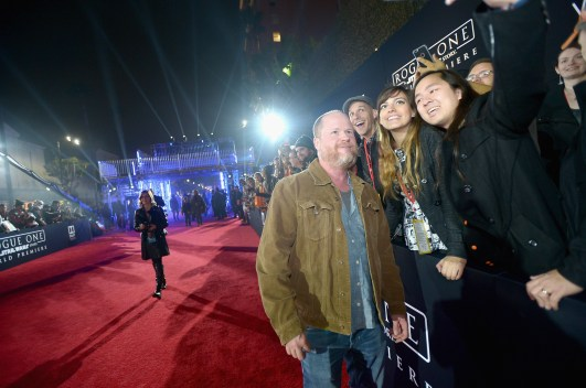 "HOLLYWOOD, CA - DECEMBER 10: Director Joss Whedon (L) takes a selfie with fans at The World Premiere of Lucasfilm's highly anticipated, first-ever, standalone Star Wars adventure, ""Rogue One: A Star Wars Story"" at the Pantages Theatre on December 10, 2016 in Hollywood, California. (Photo by Charley Gallay/Getty Images for Disney) *** Local Caption *** Joss Whedon"