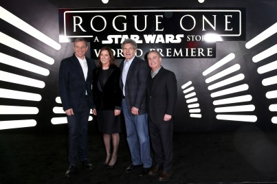 """HOLLYWOOD, CA - DECEMBER 10: (L-R) The Walt Disney Company Chairman and CEO Bob Iger, producer Kathleen Kennedy, The Walt Disney Studios Chairman Alan Horn, and The Walt Disney Studios President Alan Bergman attend The World Premiere of Lucasfilm's highly anticipated, first-ever, standalone Star Wars adventure, """"Rogue One: A Star Wars Story"""" at the Pantages Theatre on December 10, 2016 in Hollywood, California. (Photo by Joe Scarnici/Getty Images for Disney) *** Local Caption *** Bob Iger; Kathleen Kennedy; Alan Horn; Alan Bergman"""