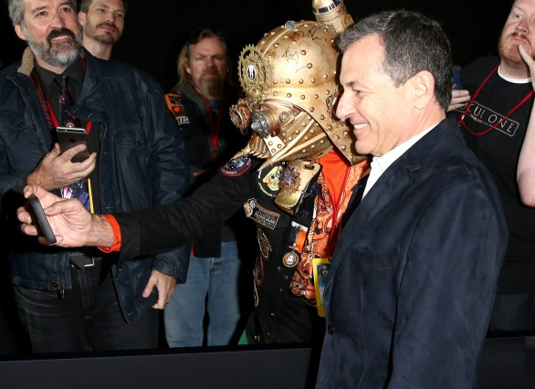 """HOLLYWOOD, CA - DECEMBER 10: The Walt Disney Company Chairman/CEO Bob Iger (R) takes a selfie with Christopher 'Dude Vader' Canole at The World Premiere of Lucasfilm's highly anticipated, first-ever, standalone Star Wars adventure, """"Rogue One: A Star Wars Story"""" at the Pantages Theatre on December 10, 2016 in Hollywood, California. (Photo by Joe Scarnici/Getty Images for Disney) *** Local Caption *** Bob Iger; Christopher Canole"""