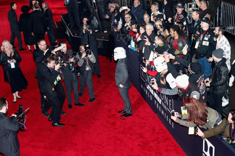 """HOLLYWOOD, CA - DECEMBER 10: Director Gareth Edwards (C) poses wearing a Stormtrooper helmet at The World Premiere of Lucasfilm's highly anticipated, first-ever, standalone Star Wars adventure, """"Rogue One: A Star Wars Story"""" at the Pantages Theatre on December 10, 2016 in Hollywood, California. (Photo by Rich Polk/Getty Images for Disney) *** Local Caption *** Gareth Edwards"""