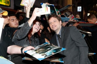 """HOLLYWOOD, CA - DECEMBER 10: Director Gareth Edwards (R) poses for a selfie with fans at The World Premiere of Lucasfilm's highly anticipated, first-ever, standalone Star Wars adventure, """"Rogue One: A Star Wars Story"""" at the Pantages Theatre on December 10, 2016 in Hollywood, California. (Photo by Rich Polk/Getty Images for Disney) *** Local Caption *** Gareth Edwards"""