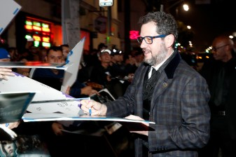 "HOLLYWOOD, CA - DECEMBER 10: Composer Michael Giacchino (R) signs autographs at The World Premiere of Lucasfilm's highly anticipated, first-ever, standalone Star Wars adventure, ""Rogue One: A Star Wars Story"" at the Pantages Theatre on December 10, 2016 in Hollywood, California. (Photo by Rich Polk/Getty Images for Disney) *** Local Caption *** Michael Giacchino"