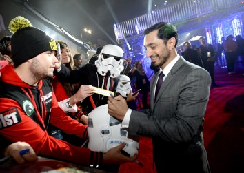 "HOLLYWOOD, CA - DECEMBER 10: Actor Riz Ahmed (R) signs autographs for fans at The World Premiere of Lucasfilm's highly anticipated, first-ever, standalone Star Wars adventure, ""Rogue One: A Star Wars Story"" at the Pantages Theatre on December 10, 2016 in Hollywood, California. (Photo by Charley Gallay/Getty Images for Disney) *** Local Caption *** Riz Ahmed"
