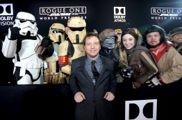 """HOLLYWOOD, CA - DECEMBER 10: Actor Gareth Edwards (C) poses with costumed fans at The World Premiere of Lucasfilm's highly anticipated, first-ever, standalone Star Wars adventure, """"Rogue One: A Star Wars Story"""" at the Pantages Theatre on December 10, 2016 in Hollywood, California. (Photo by Charley Gallay/Getty Images for Disney) *** Local Caption *** Gareth Edwards"""