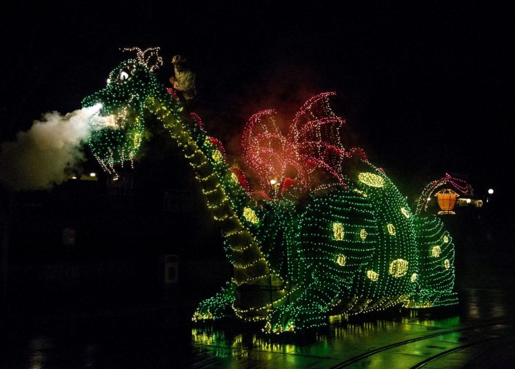 A COLORFUL HOMECOMING Ð The Elliot dragon float from the classic 1977 Disney film ÒPeteÕs DragonÓ travels down the parade route at Disneyland park for the return of the Main Street Electrical Parade. The massive float decorated in thousands of twinkling green lights weighs 5,600 pounds, and measures 16 feet tall, 10 feet wide and 38 feet long. The Main Street Electrical Parade will run for a limited-time, through June 18, 2017, at Disneyland park. (Scott Brinegar/Disneyland)