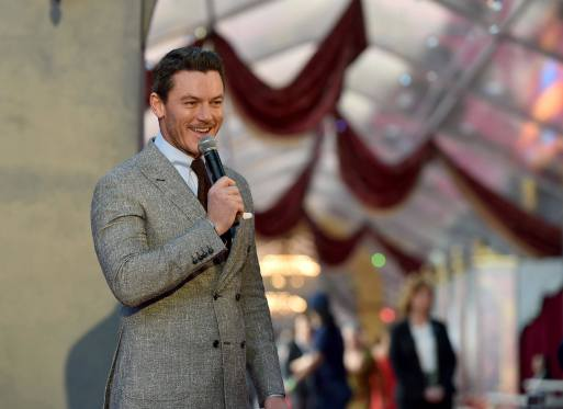 """LOS ANGELES, CA - MARCH 02: Actor Luke Evans performs at the world premiere of Disney's live-action """"Beauty and the Beast"""" at the El Capitan Theatre in Hollywood as the cast and filmmakers continue their worldwide publicity tour on March 2, 2017 in Los Angeles, California. (Photo by Alberto E. Rodriguez/Getty Images for Disney)"""