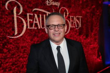 """Bill Condon arrives for the world premiere of Disney's live-action """"Beauty and the Beast"""" at the El Capitan Theatre in Hollywood as the cast and filmmakers continue their worldwide publicity tour. (Photo: Alex J. Berliner/ABImages)"""