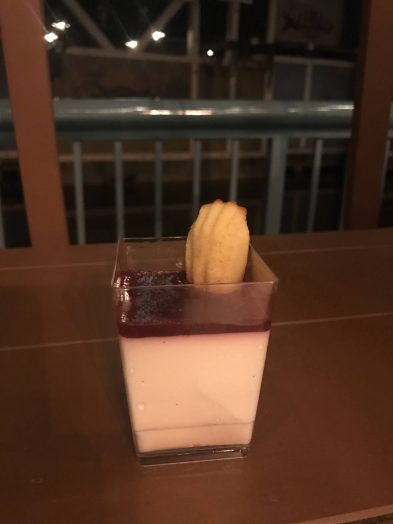Vanilla bean crème fraîche panna cotta with Amarena cherry jus and EVOO madeleine