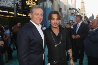 "HOLLYWOOD, CA - MAY 18: The Walt Disney Company Chairman and CEO Bob Iger (L) and Actor Johnny Depp at the Premiere of Disney's and Jerry Bruckheimer Films' ""Pirates of the Caribbean: Dead Men Tell No Tales,"" at the Dolby Theatre in Hollywood, CA with Johnny Depp as the one-and-only Captain Jack in a rollicking new tale of the high seas infused with the elements of fantasy, humor and action that have resulted in an international phenomenon for the past 13 years. May 18, 2017 in Hollywood, California. (Photo by Jesse Grant/Getty Images for Disney) *** Local Caption *** Bob Iger; Johnny Depp"