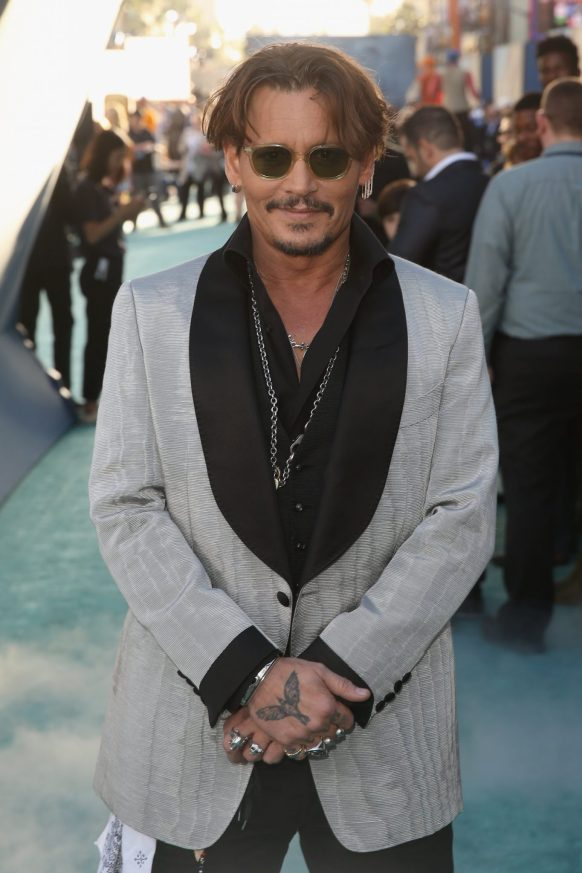 "HOLLYWOOD, CA - MAY 18: Actor Johnny Depp at the Premiere of Disney's and Jerry Bruckheimer Films' ""Pirates of the Caribbean: Dead Men Tell No Tales,"" at the Dolby Theatre in Hollywood, CA with Johnny Depp as the one-and-only Captain Jack in a rollicking new tale of the high seas infused with the elements of fantasy, humor and action that have resulted in an international phenomenon for the past 13 years. May 18, 2017 in Hollywood, California. (Photo by Jesse Grant/Getty Images for Disney) *** Local Caption *** Johnny Depp"